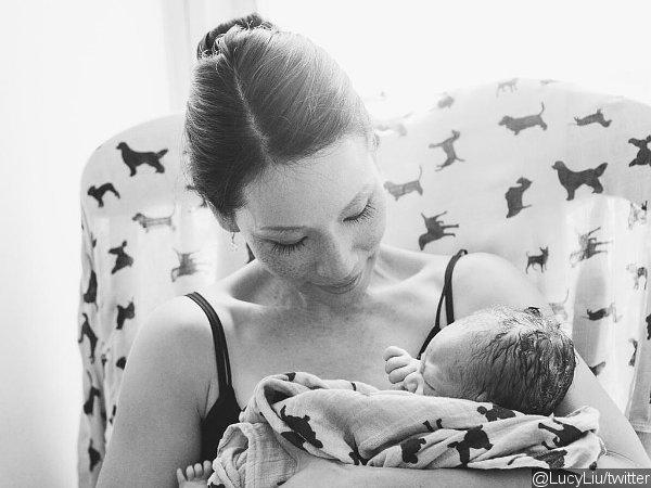 Люси Лью показала своего новорожденного сына